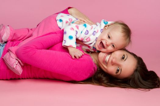 Mother and child laughing playing