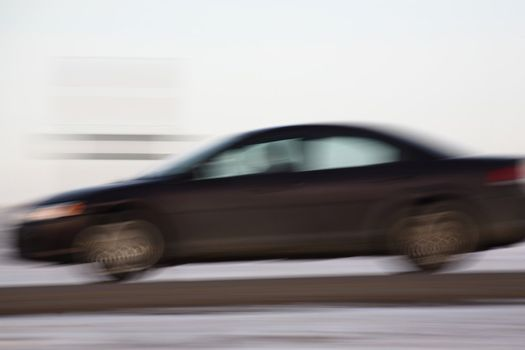 Blurred automobile on highway