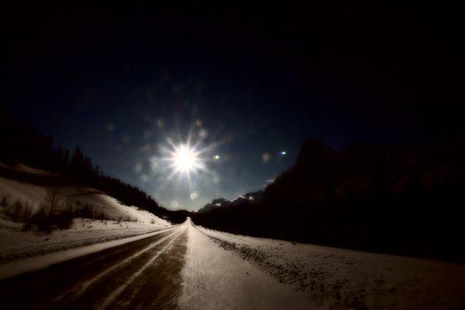 Sun glare down winter road