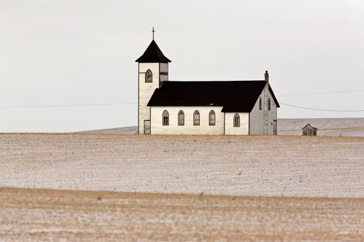 Lone country church on snow covered Prairies