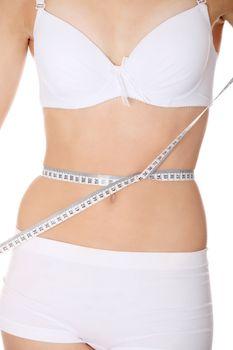 Woman measuring perfect shape of beautiful thigh waist.