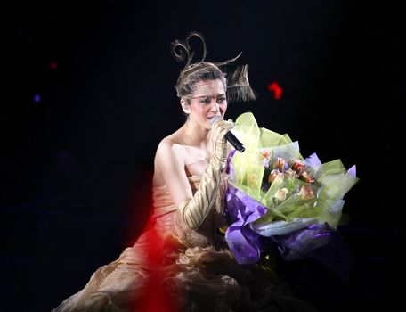 "HONG KONG - FEB 26: Chinese popular singer and actress Gigi Leung performs on stage at her concert ""Hong Kong G night"" at Hong Kong Coliseum on February 26, 2011 in Hong Kong, China."