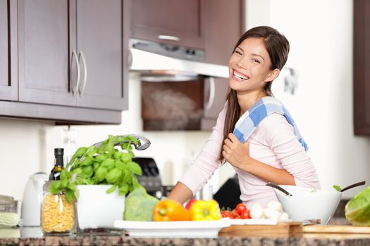 woman in kitchen making food happy