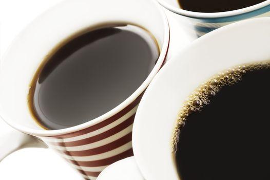 Close ups of mugs of black coffee