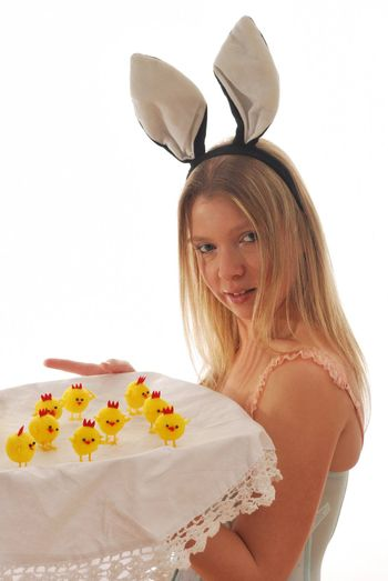 Bunny girl with tray of chicks