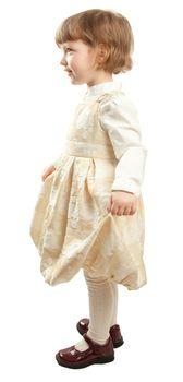 Dancing little girl in dress. Studio shot isolated on white.