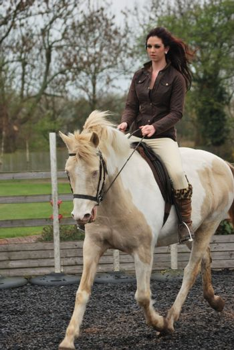 pretty girl riding horse