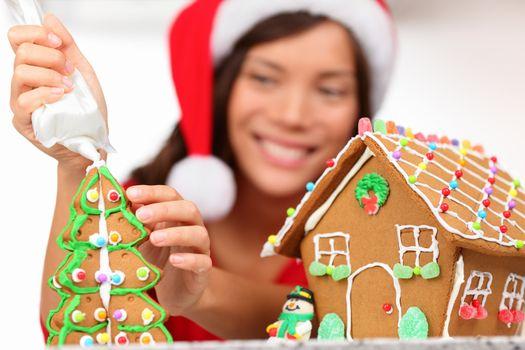 girl making gingerbread house