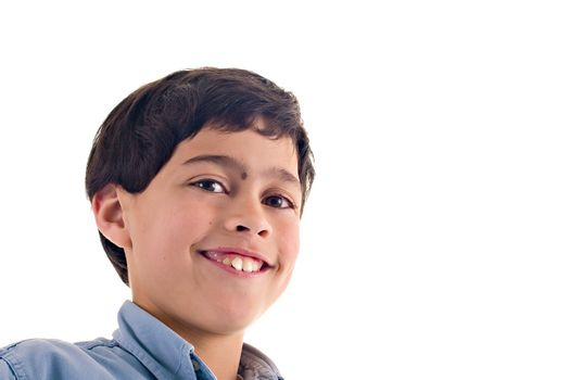 Close up of a latin boy with a cute expression, over white background with copy space.