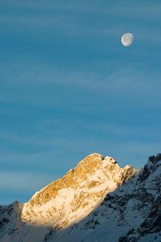 Moon over Mountain at Sunrise