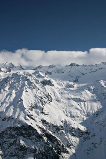 View over a snowy mountain in the Swiss Alps.