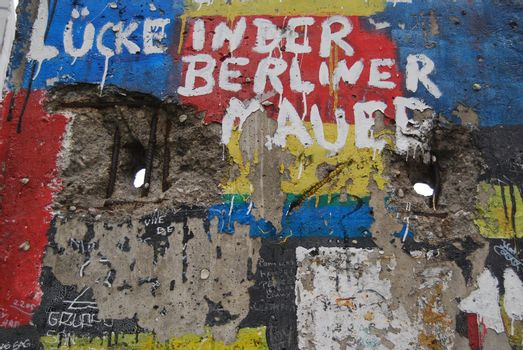 Berlinwall with grafitti and holes