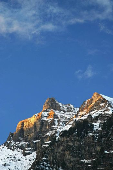 Mountain top lighten by sunset light. Swiss Alps, Grindelwald.