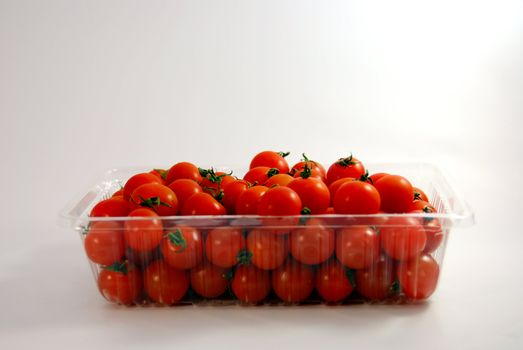 Cherry Tomatoes in A Clear Plastic Punnet.