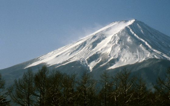 Mount Fuji, stands cold and  windswept.