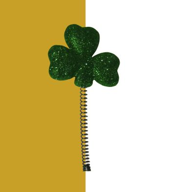 cutout of a coiled shamrock