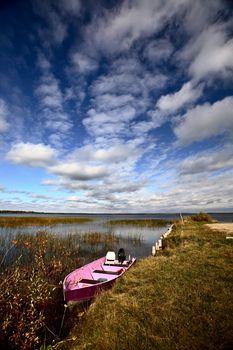 Pink boat in scenic Saskatchewan