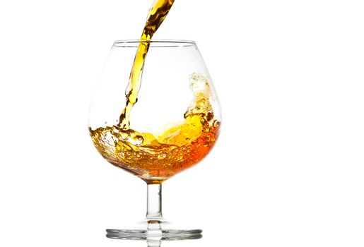 filling a glass of brandy