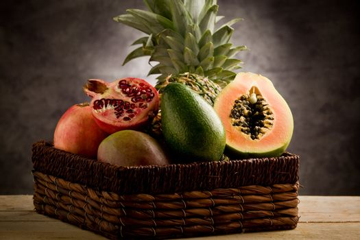 Basket with tropical fruits