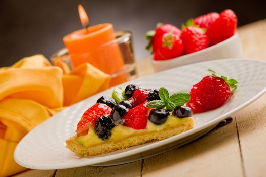 Pie with candle and strawberries