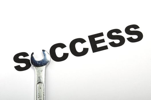 success concept with word and tool showing business growth