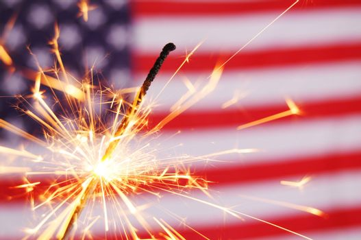 fourth of july concept with sparkler and usa flag
