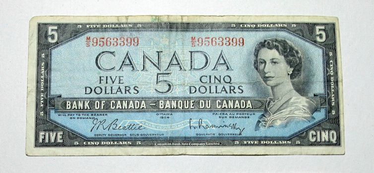 Close up of old canadian five dollar bill