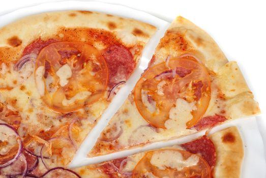 pizza closeup with salami, tomato, onion and mozzarella cheese