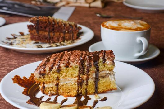 Dessert cakes with banana and coffee at table