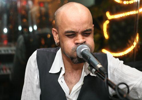 "Singer at an alive concert in a night club ""La vida loka"". Bali. Indonesia"
