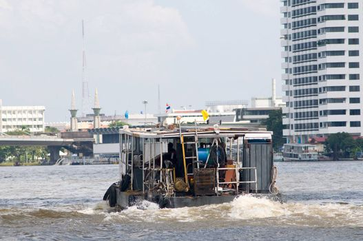 Utility vessel on the Chao Praya River in Bangkok, Thailand