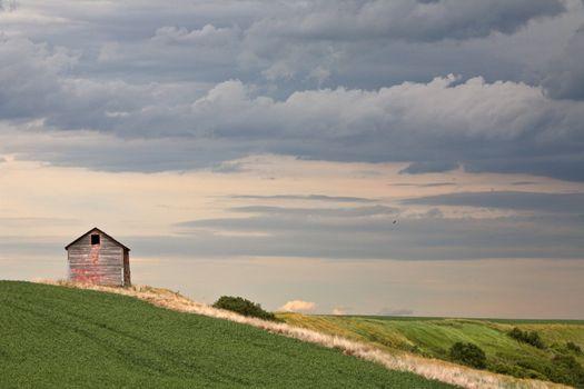 Cloudy skies over an old Saskatchewan granary