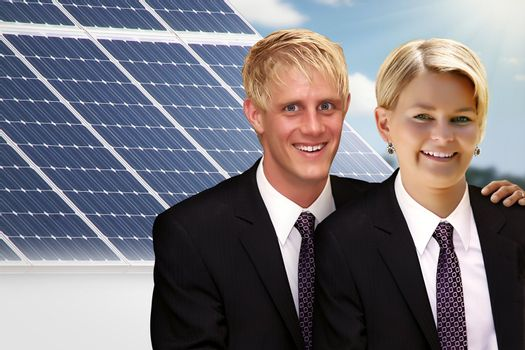 young couple in front of their solar roof