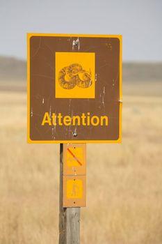 Rattlesnake attention road sign in scenic Saskatchewan