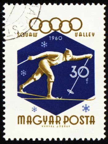 HUNGARY - CIRCA 1960: A post stamp printed in HUNGARY - CIRCA 1960: A post stamp printed in Hungary shows running skier, dedicated to the 8th Olympic Winter Games in Squaw Valley, series, circa 1960