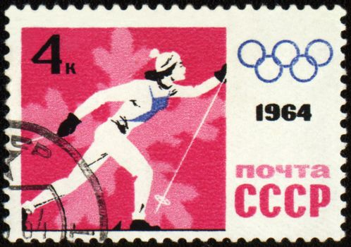 USSR - CIRCA 1964: A post stamp printed in USSR shows running skier, devoted to the Olympic Winter Games in Innsbruck, series, circa 1964