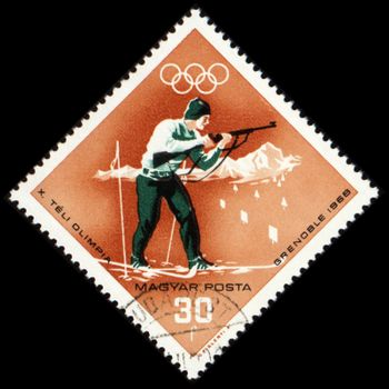 HUNGARY - CIRCA 1968: A post stamp printed in Hungary shows biathlete with rifle, dedicated to the Olympic Winter Games in Grenoble, series, circa 1968