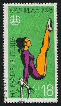 BULGARIA - CIRCA 1976: stamp printed by Bulgaria, shows woman gymnast, circa 1976.