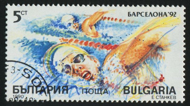 BULGARIA - CIRCA 1990: stamp printed by Bulgaria, shows swimming, circa 1990.