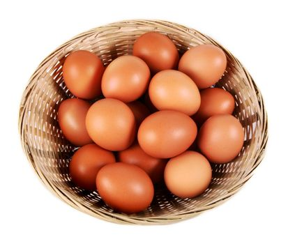 Eggs in a basket isolated on white