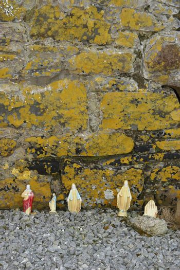 religious stauettes against a wall