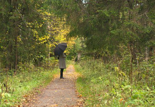 women vaiting long alley at fall autumn season