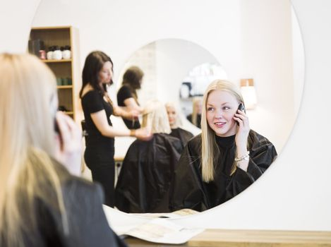 Girl on the Phone at the Hair Salon