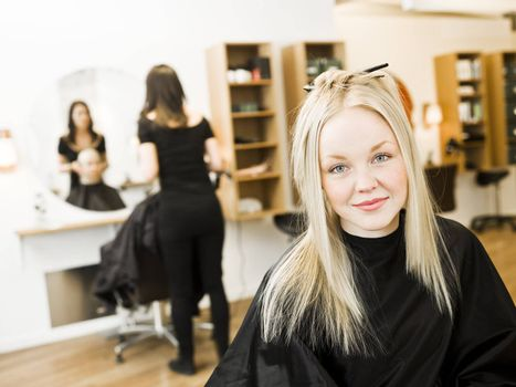 Young Blond Girl in the Hair Salon