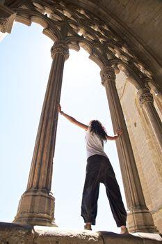 woman between great columns