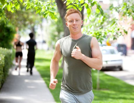 Close-up of man running against blur background