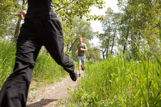 Happy men jogging at the park with his friend