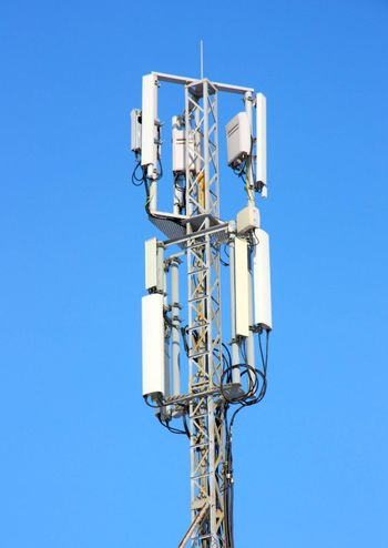 Aerial mobile communication  against the blue sky