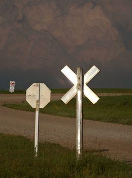 Storm clouds building beyond a Saskatchewan road junction