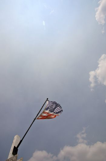Partially torm American flag waving in the breeze